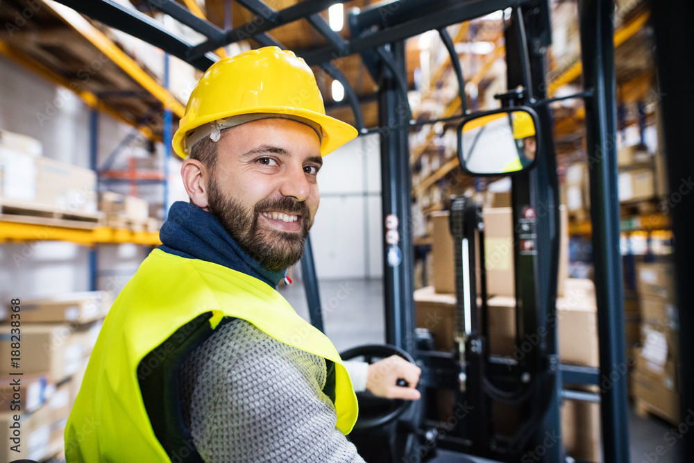 Fototapeta Warehouse man worker with forklift.