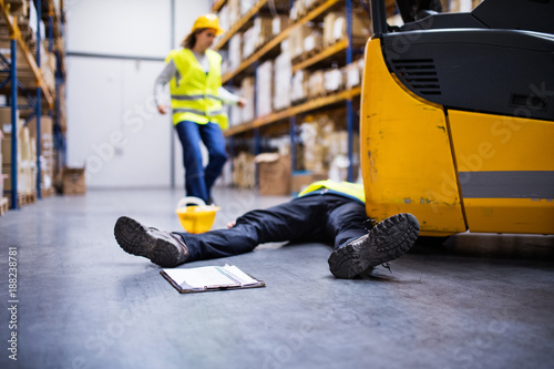 An injured worker after an accident in a warehouse. Wallpaper Mural