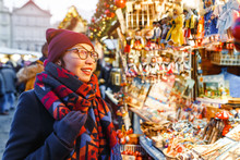Stylish Woman Buys Gifts And Souvenirs At The Christmas Market In Prague