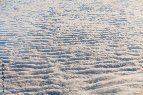 Photo Clouds seen from airplane, concept of weather and climate change, cyclones and a