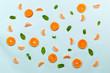 Leinwanddruck Bild - Healthy food fruits pattern with orange mandarin cloves, green mint leafs and orange slices isolated on azure blue background