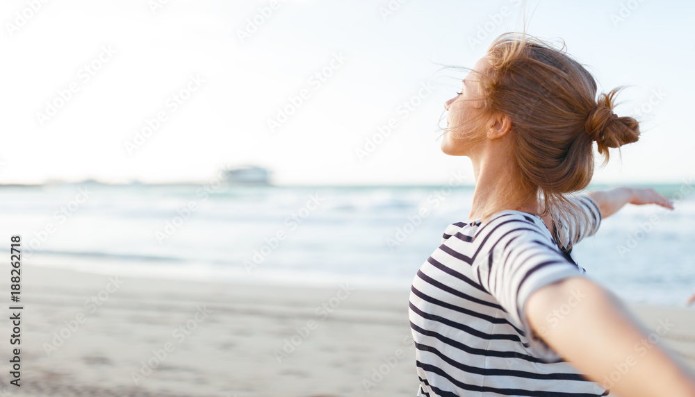 Fototapety, obrazy: happy woman enjoying freedom with open hands on sea