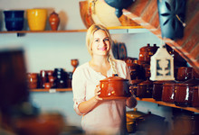 Young Woman Selecting Ceramic ...