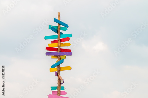 Fotomural Colorful wooden direction arrow signs