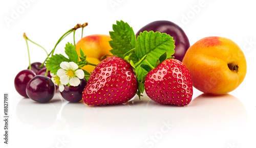 Fototapeta Berry mix with strawberry and raspberry. Fruity still life green obraz