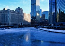 Frigid, Blue Morning In Chicago During January Freeze With View Of A Frozen River Near Merchandise Mart Building.