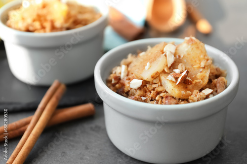 Ramekin with apple crisp on table, closeup