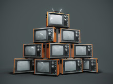 Pile Of Old Retro TVs On Dark Background
