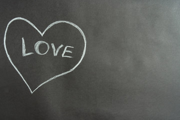 Drawing in white pencil: heart with the inscription