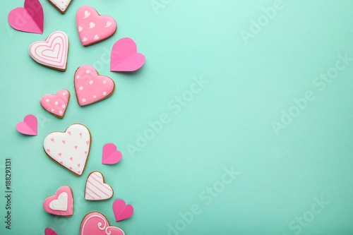 Homemade valentine cookies on mint background