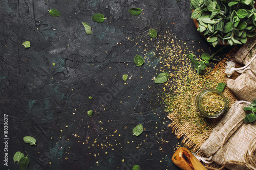 Dried ground oregano or marjoram, dark background, top view