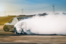 Drift Driving Is Approaching The High Speed Curve And Has A Lot Of Smoke. This Image Is Motion Blur.