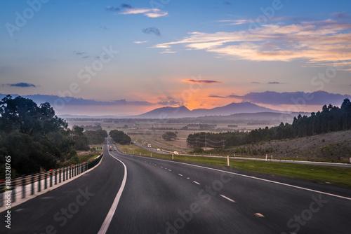 Australian road trip, motion blur highway landscape at dusk with mountain Ararat
