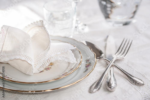 Fotografie, Obraz  Luxury dinner set with silverware, elegant porcelain dishes, crystal glassware a