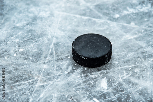 hockey puck lies on the snow close-up