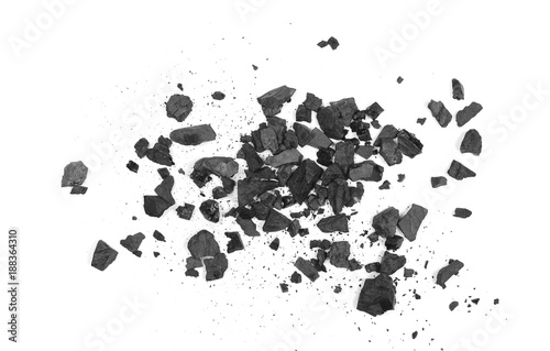 Fotoposter Brandhout textuur Pile black coal isolated on white background, top view