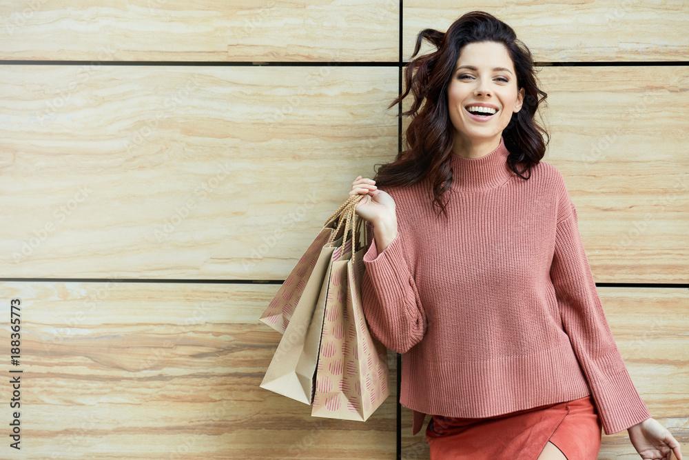 Fototapeta Beautiful young woman with shopping bags