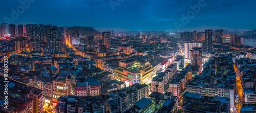 High angle view of city illuminated at night