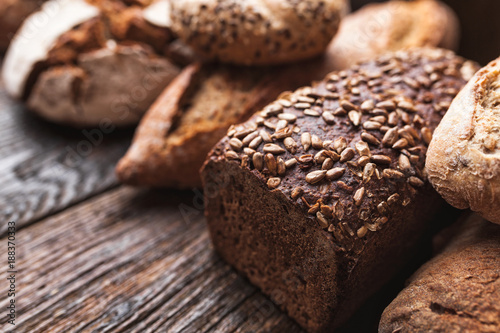 Poster Bread Delicious fresh bread on wooden background