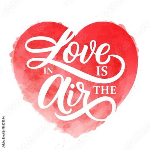 milosc-jest-w-powietrzu-napis-haslem-na-bogatym-czerwonym-tle-akwarela-serca