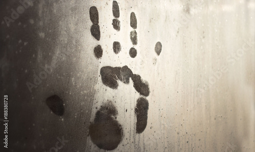 Fotografie, Obraz  A handprint on the misted-on window