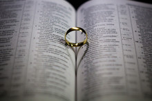 Heart-shaped Shadow On Bible