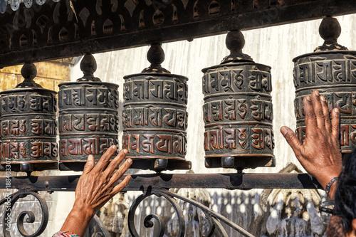 Spinning Prayer wheels, Swayambhunath, Kathmandu, Nepal - Buy this stock  photo and explore similar images at Adobe Stock | Adobe Stock