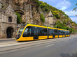The modern yellow tram in Budapest.