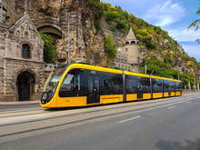 The Modern Yellow Tram In Buda...