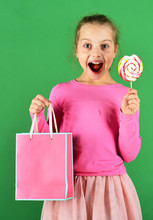 Girl With Lollipop And Shoppin...
