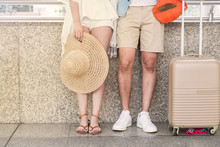 A Traveler Couple  Go For Holiday Travel Vacation Together With Luggage. Waiting For A Transportation.