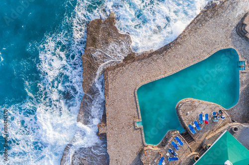 Poster Taupe Aerial view of the coast of Montenegro. Storm waves on the Ploče beach.