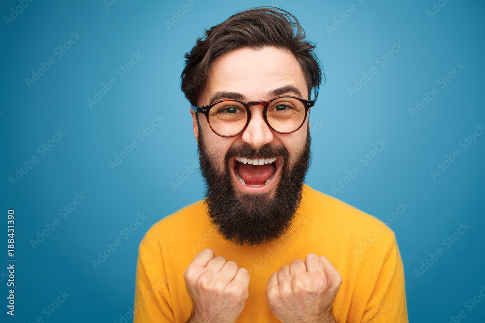 Fototapeta Excited bearded man in glasses
