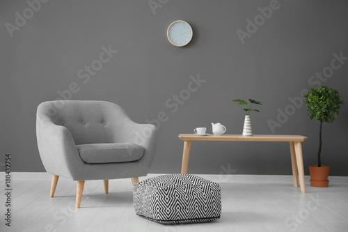 Valokuva  Elegant living room interior with comfortable armchair