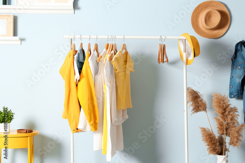 Fotografía  Collection of clothes hanging on rack in dressing room