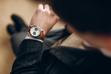 Businessman Is Checking Time On His Modern Wrist Watch. Top View