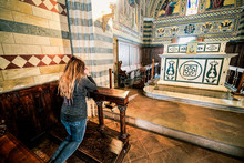 Girl Pray Kneeling In A Church...