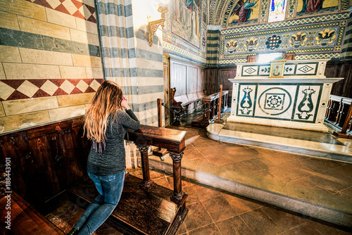 Photo  Girl pray kneeling in a church, religious subjects