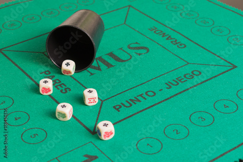 Five poker dices of ases and beaker on the green casino field Canvas Print