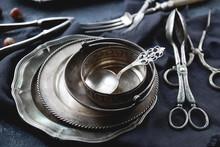 Vintage Silver Cutlery On Dark Stone Background. Old Kitchen Utensils