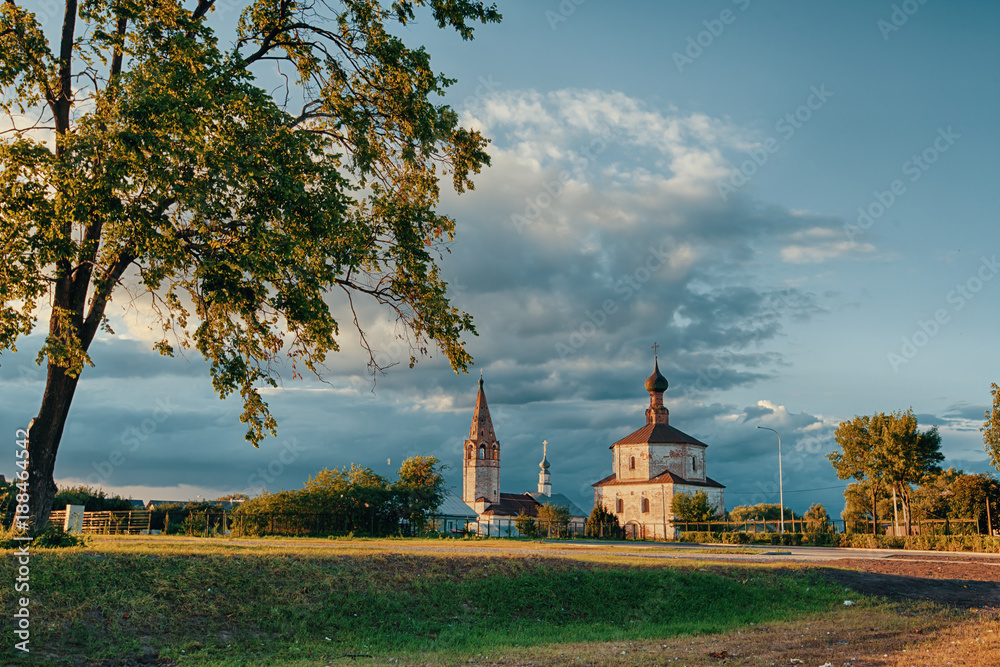 Fototapety, obrazy: church in the summer/ The church in Suzdal at sunset in the summer.