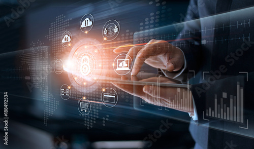 Businessman touching technology global networking security information safety and encryption with icons on virtual screen , Data protection and Cyber security concept