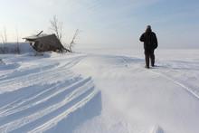 Man Walking Along The Frozen S...