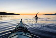 Adventure Woman Kayaking On A ...