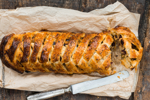 Fotografie, Obraz  Pork roll - spicy sausage meat with chillies and beans in puff pastry