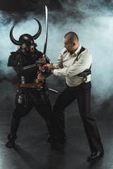 armored samurai fighting with man who holding gun