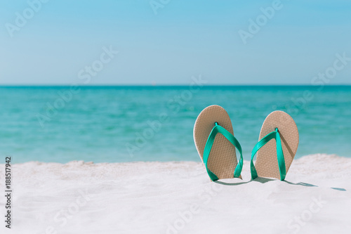 Ocean Landscape And Sandals On The Beach Welcome Summer