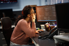 Female Programmer Working On New Project.She Working Late At Night In Her Office.