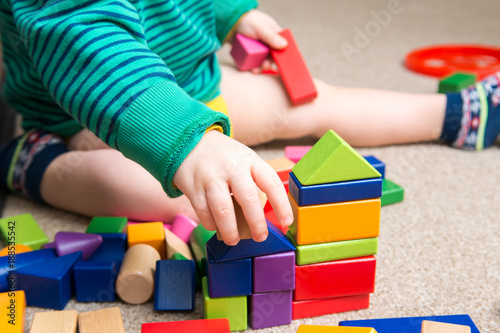 Tela Child playing with building blocks learning new skills
