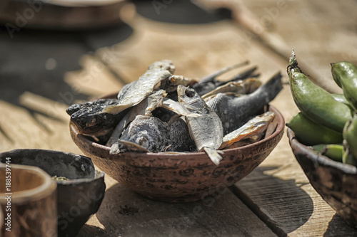 Valokuva  Cured fish in a ceramic bowl on a table